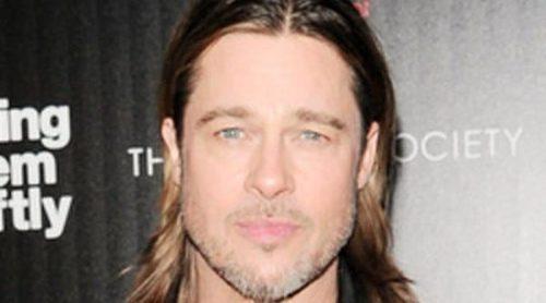 Brad Pitt cambia a Angelina Jolie por Doutzen Kroes en el estreno de 'Mátalos suavemente' en Nueva York