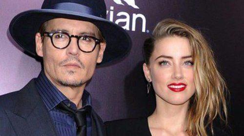Johnny Depp y Amber Heard pasean su amor por primera vez por la alfombra roja