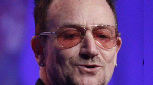 Bono pide delante de Merkel y Rajoy una campaña de la UE para ayudar a España