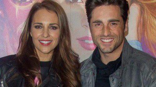 Paula Echevarría y David Bustamante disfrutan a duras penas del concierto de 'Violetta' en Madrid