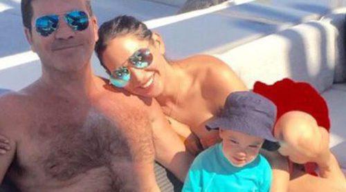 Retrato de familia feliz: Simon Cowell disfruta de Ibiza con Lauren Silverman y su hijo Eric