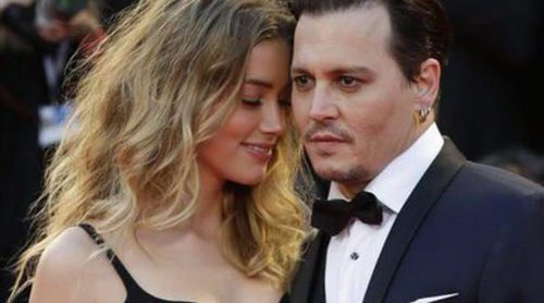 Pasión en estado puro: Johnny Depp y Amber Heard se olvidan de las cámaras en la Mostra 2015