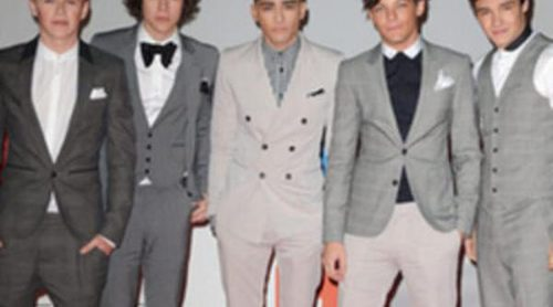 Unos fans de One Direction se esconden en cubos de basura para ver a sus ídolos
