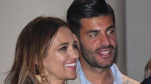 Paula Echevarría y Miguel Torres disfrutan de la Semana Santa de Málaga entre sonrisas y besos