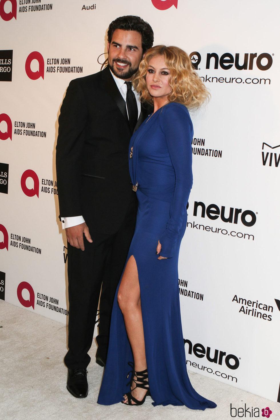 Paulina Rubio y Gerardo Bazúa en la Gala de Elton John tras los Oscar 2014