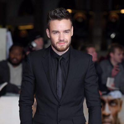Liam Payne posando en la alfombra roja de 'I Am Bolt'