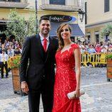 Felipe Reyes y su mujer Kirenia Cabrera en la boda de Sergio Llul y Almudena Cánovas