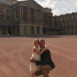 David Beckham y su hija Harper Seven en el Buckingham Palace