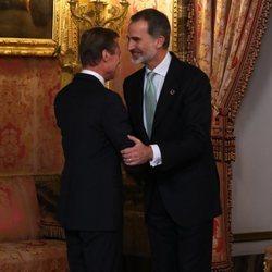 El Rey Felipe saluda a Enrique de Luxemburgo en la recepción por la Conferencia sobre el Cambio Climático