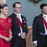 Victoria y Daniel de Suecia y Carlos Felipe de Suecia en la cena de gala al Presidente de Alemania y su esposa