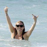 Kesha hace una peineta a los fotógrafos