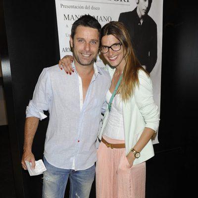 Laura Sanchez y David Ascanio en el evento de Enrique Heredia