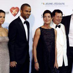 Axelle, Tony Parker, Carolina de Mónaco y Axelle en una gala benéfica en Monte-Carlo