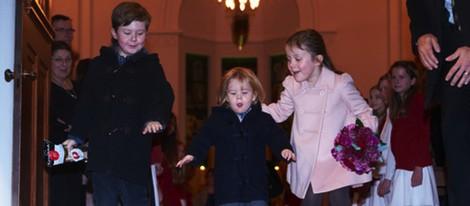 Christian, Vicente e Isabel de Dinamarca en un concierto de Navidad