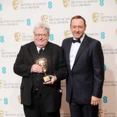 Alan Parker y Kevin Spacey en los BAFTA 2013
