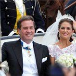 La Princesa Magdalena de Suecia y Chris O'Neill saludando como marido y mujer