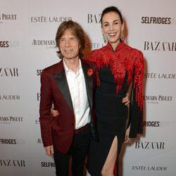 Mick Jagger y L'Wren Scott en la fiesta Harper's Bazaar Mujer del Año 2013