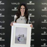 Malú recibe el Doble Disco de Platino durante la presentación de su 'Tour Sí'