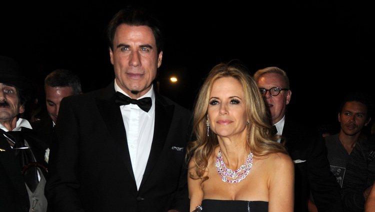 John Travolta y Kelly Preston en una fiesta en el yate de Roberto Cavalli en Cannes 2014