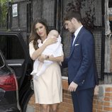 Iker Casillas y Sara Carbonero con su hijo Martín el día de su bautizo