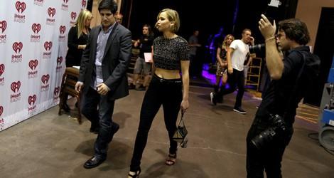 Jennifer Lawrence acude junto a Chris Martin al iHeartRadio Music Festival 2014