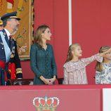 Los Reyes de España y sus hijas en el Día de la Hispanidad 2014