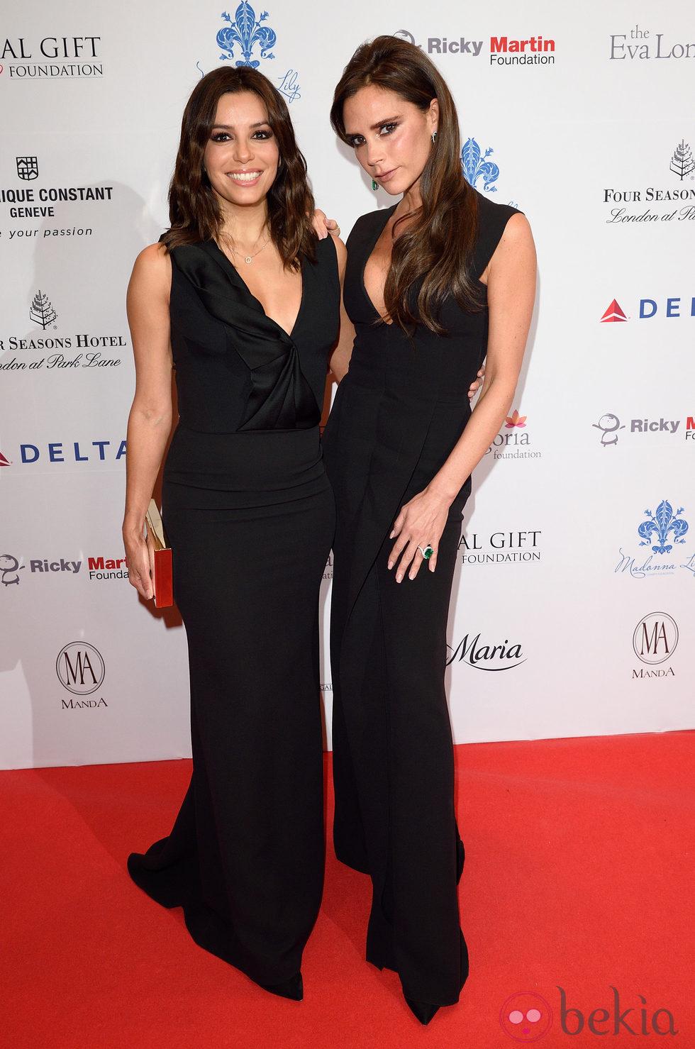 Eva Longoria y Victoria Beckham en la Global Gift Gala 2014 de Londres