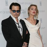 Johnny Depp y Amber Heard en la presentación de 'The Art of Elysium'