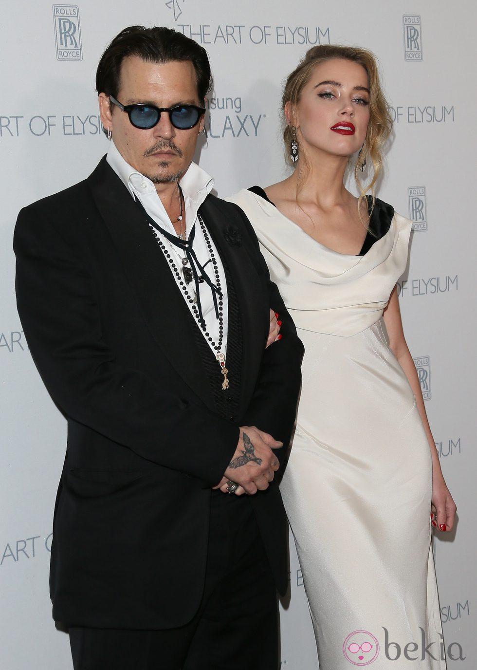 Johnny Depp y Amber Heard en la presentación de 'The Art of Elysium'