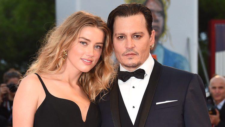 Johnny Depp y Amber Heard en el estreno de 'Black Mass' en la Mostra 2015