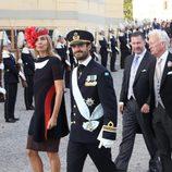 Los padrinos Natascha Aspenberg und Traun y el Príncipe Carlos Felipe en el bautizo de Nicolás de Suecia