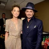 Amber Heard y Johnny Depp en los Hollywood Film Awards 2015