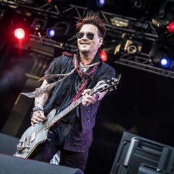 Johnny Depp ofreciendo un concierto en Estocolmo
